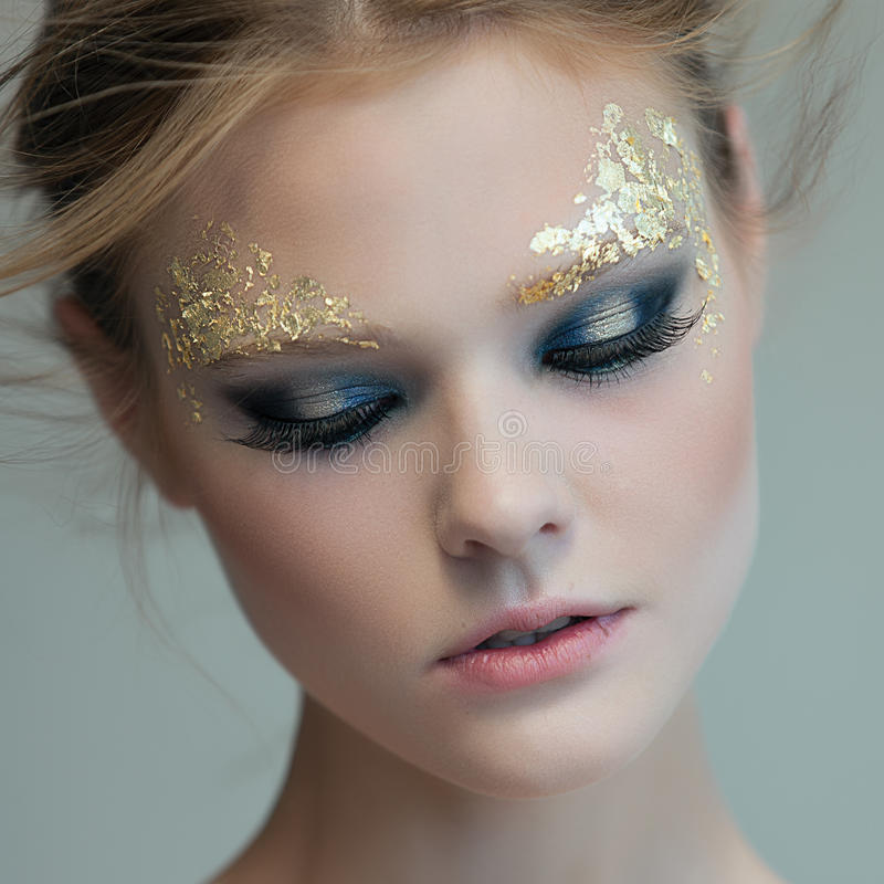 Fashion woman - beauty gilded golden make-up royalty free stock photo