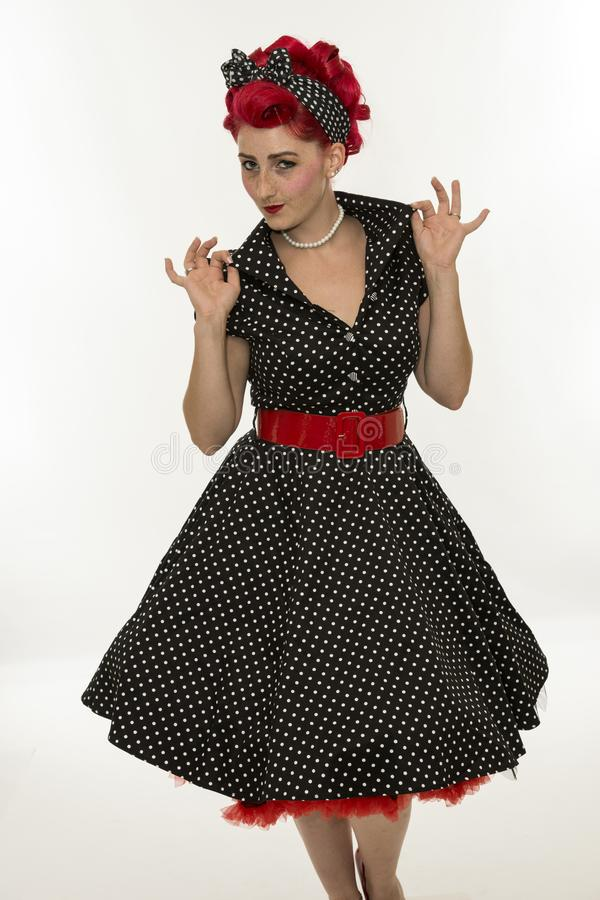Fashion pinup girl in black polka dots dress.Vintage stock photos
