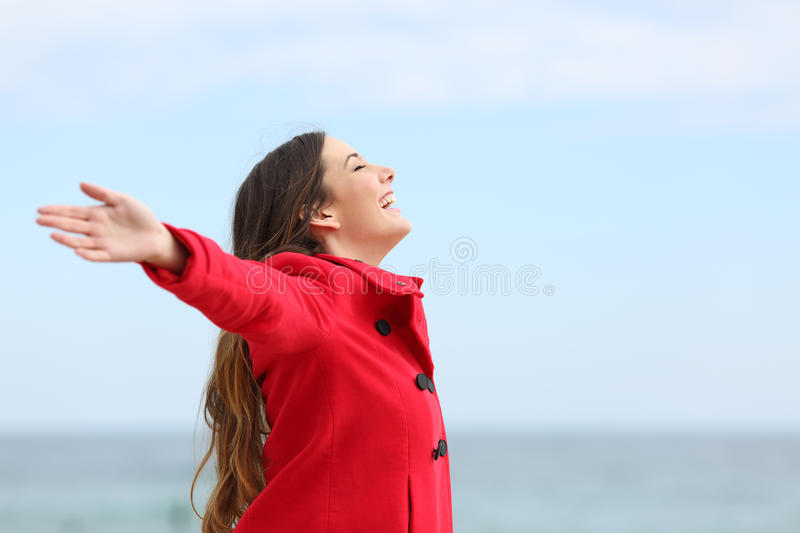 Fashion woman breathing deep fresh air in winter royalty free stock photography