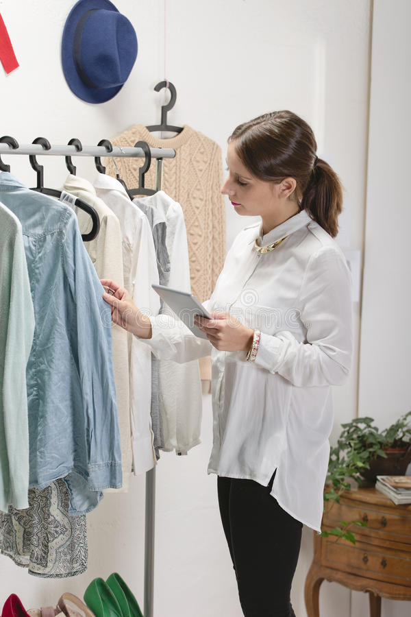 Fashion woman choosing a piece for the new collection with digit royalty free stock photos