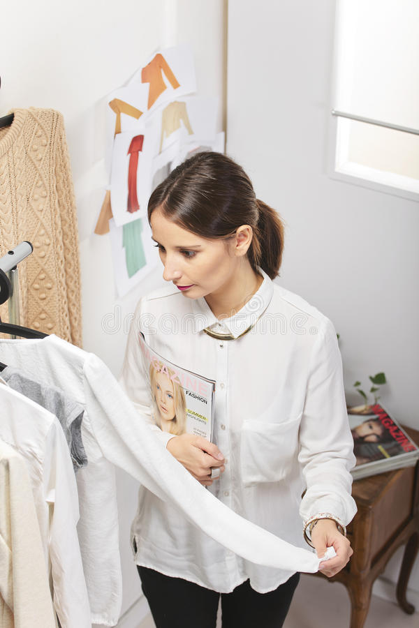 Fashion woman choosing a piece for the new collection. stock image