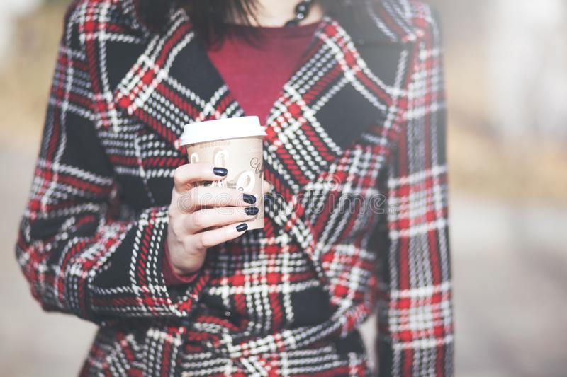 Fashion woman with cup of coffee in street at autumn stock photos