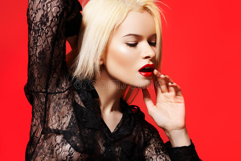 Fashion woman in dynamic model pose, lace shirt royalty free stock images