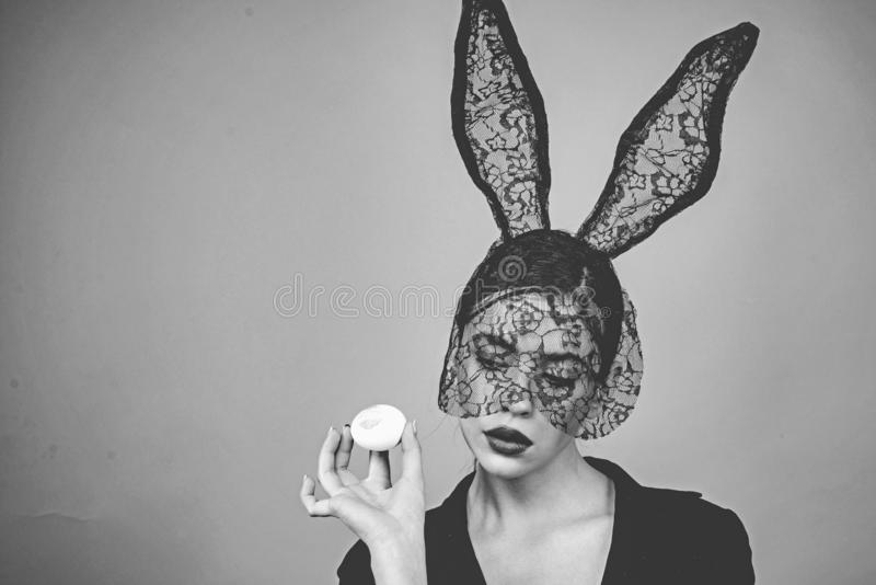 Fashion woman with easter egg. Lips and Easter, Lipstick kiss imprint on easter egg. Black and white photo. royalty free stock photos