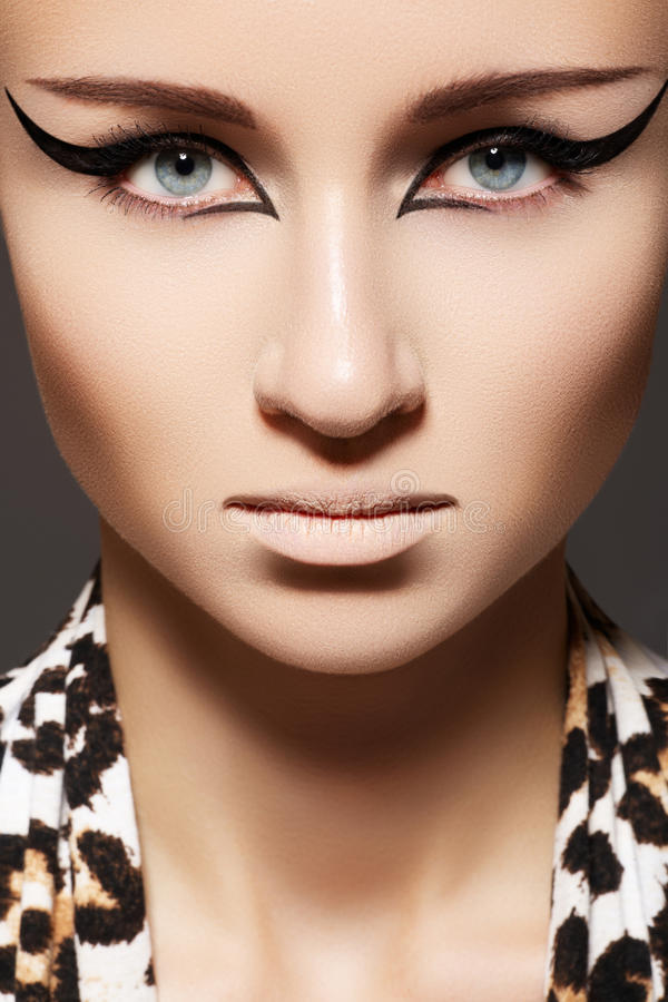 Fashion woman with eyeliner make-up, leopard scarf royalty free stock photo