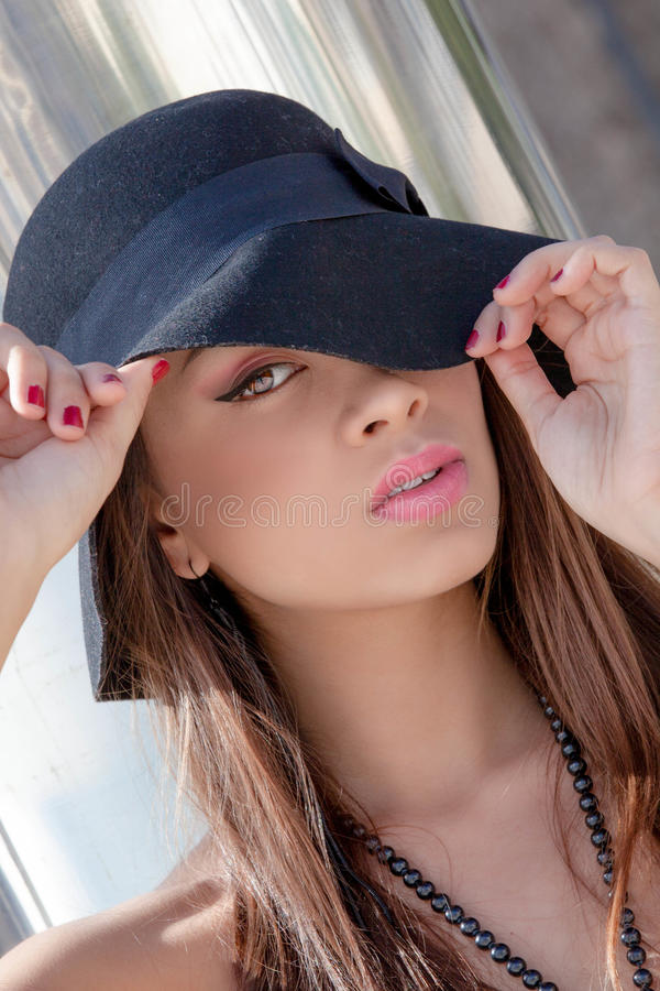 Fashion woman with hat make up and flawless skin stock photography