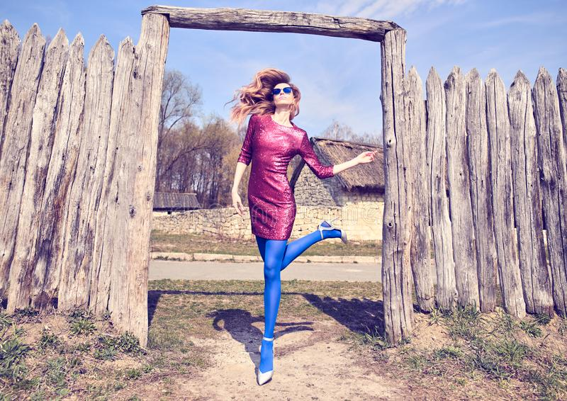 Fashion woman Having Fun dance near authentic wall royalty free stock image