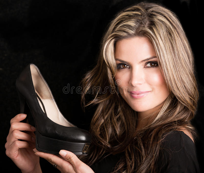 Download Woman holding shoes stock image. Image of smiling, adult - 29781395