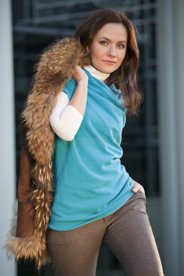 Fashion Woman Holds Fox Coat Royalty Free Stock Image