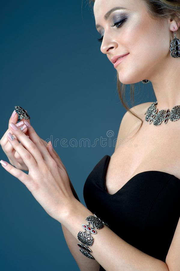 Fashion woman with jewelry set. Girl with fashionable jewelry ri stock image