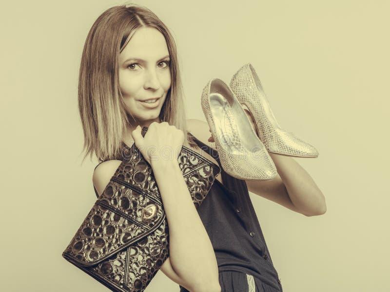 Fashion woman with leather handbag and high heels royalty free stock image