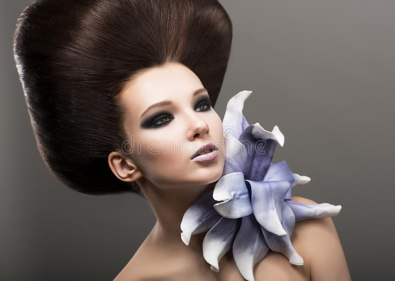 Extravagance. Classy Woman with Lily. Stylish Hair. Fashion Woman with Lily. Stylish Hairdo. Luxury stock images
