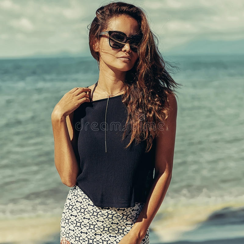Fashion woman with long curly hair outdoor portrait royalty free stock photography