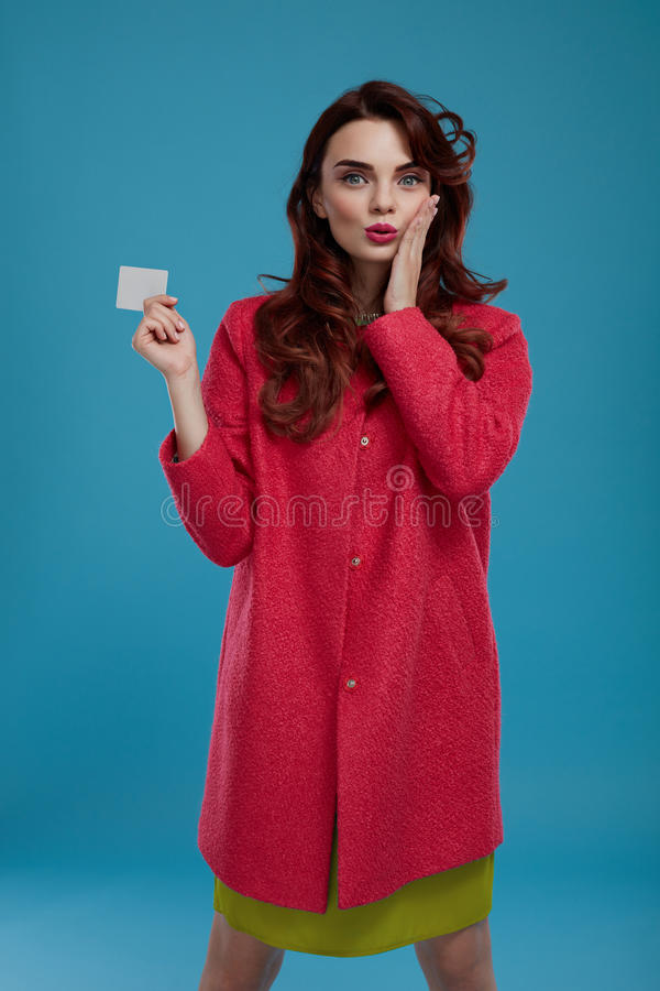 Download Fashion Woman Model Looking Surprised And Shocked Holding Card Stock Image - Image of advertising, clothing: 80396913