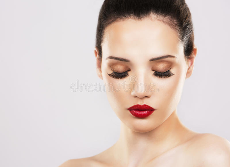Fashion woman with perfect skin wearing dramatic makeup stock images