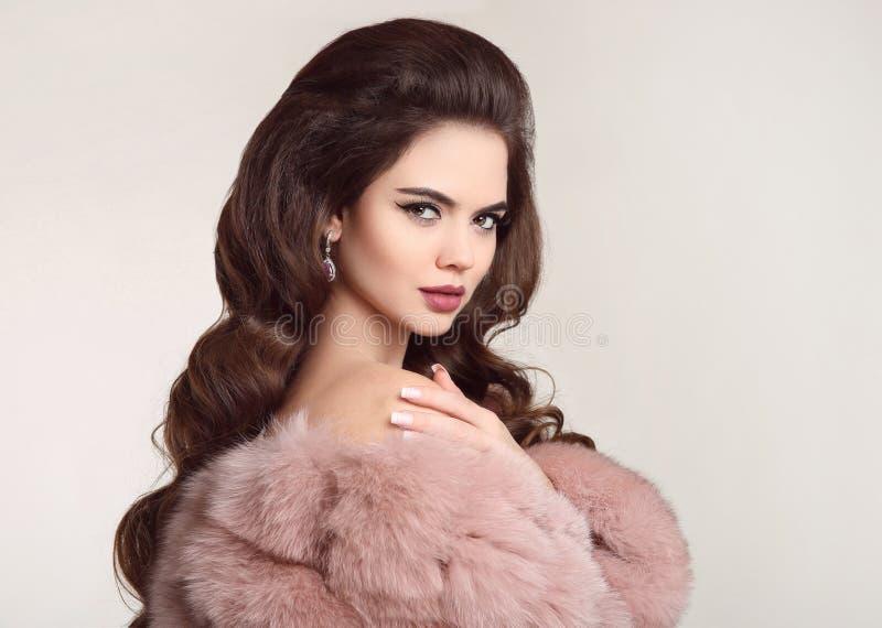Fashion woman in pink fur coat, lady portrait. Luxury glamour gi stock photo