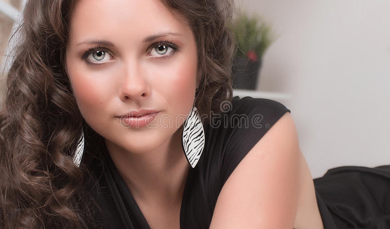 Fashion woman portrait against white wall stock photography
