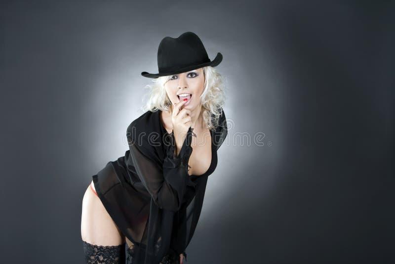 Fashion woman portrait wearing black hat stock image