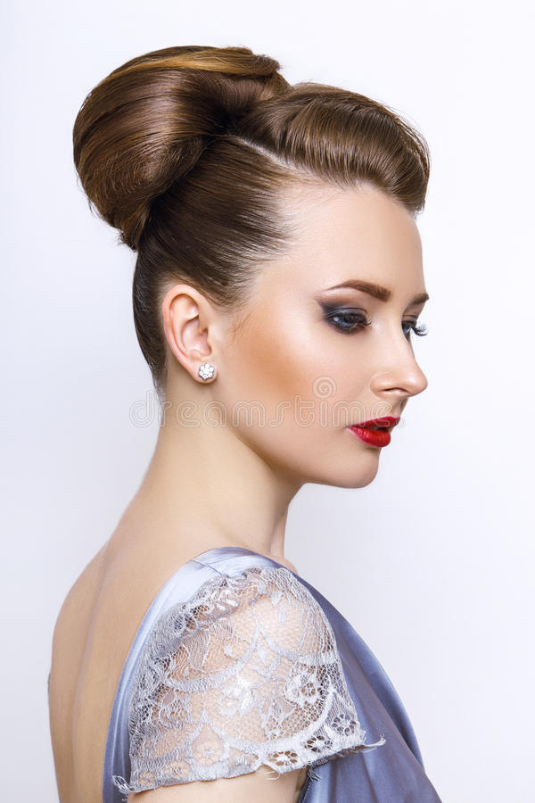 Fashion woman portrait. young model wearing silver evening dress. Hair style back vie royalty free stock image