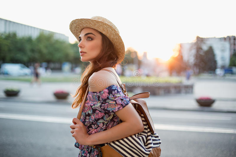 The fashion woman portrait of young pretty trendy girl posing at the city in Europe stock photography