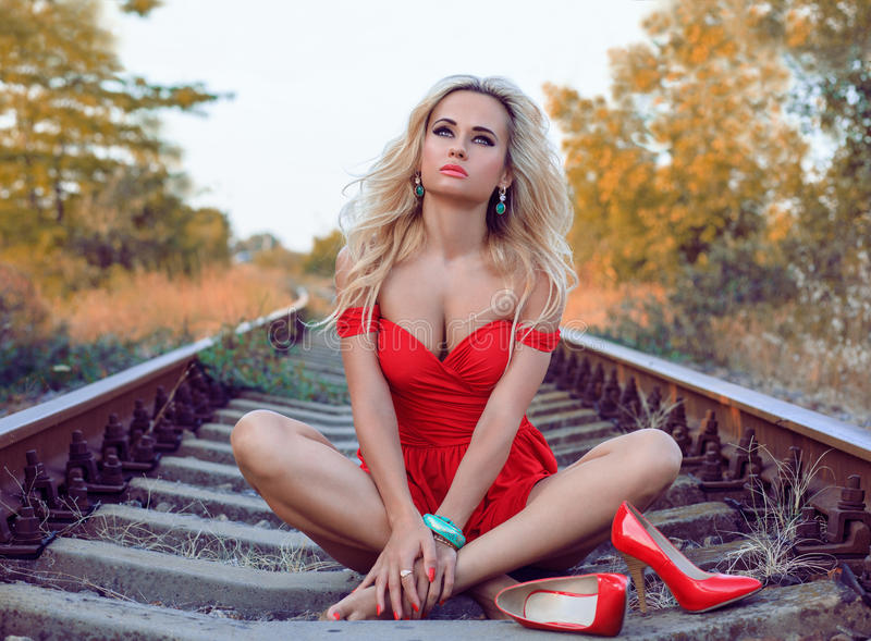 Fashion woman on railway track. royalty free stock photography