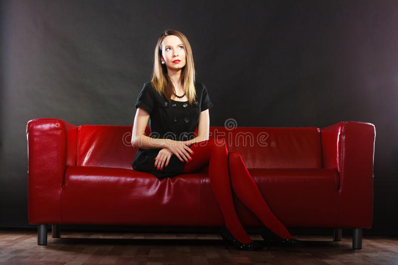 Fashion Woman In Red Pantyhose On Couch Stock Photo
