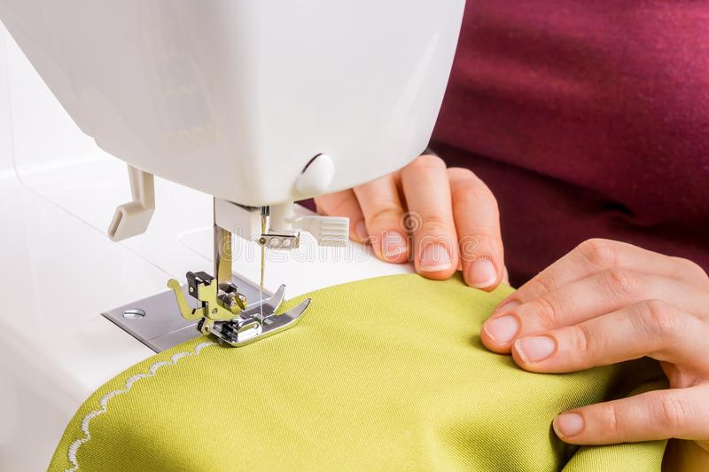 Fashion woman sews with sewing machine. Sewing concept royalty free stock image