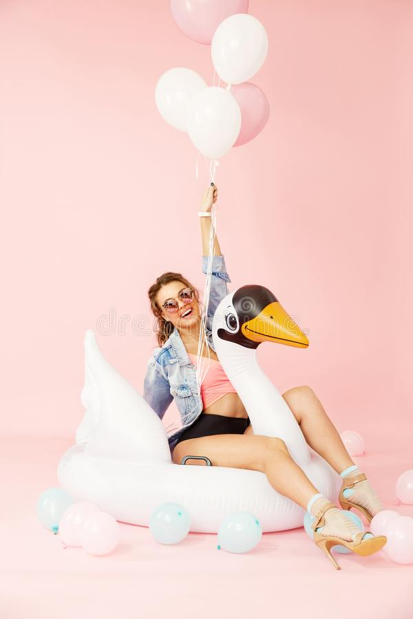 Fashion Woman In Summer Clothes Having Fun With Balloons stock photo