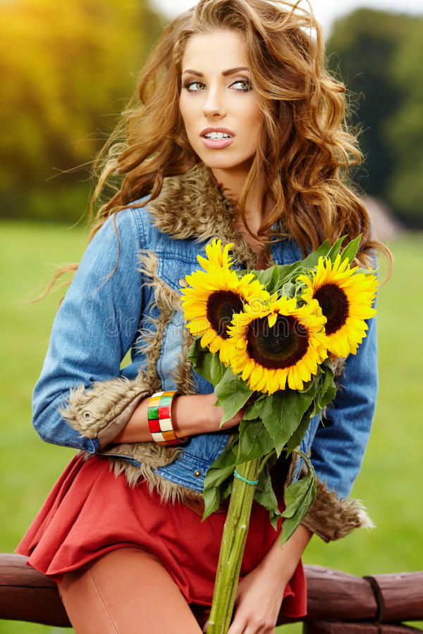 Fashion woman with sunflower stock image
