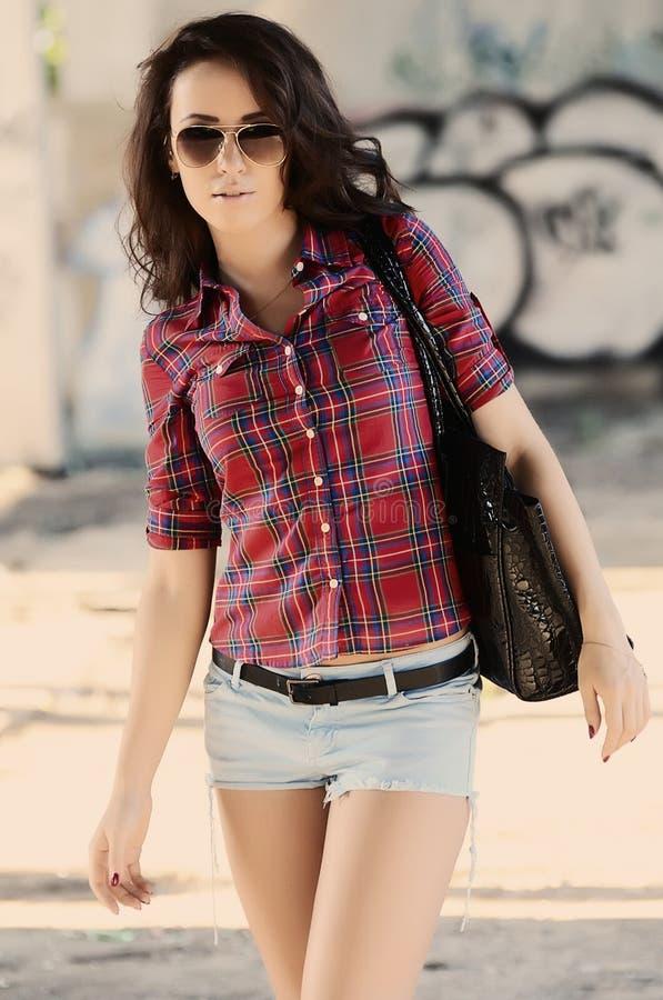 Fashion woman walking on the street royalty free stock photos