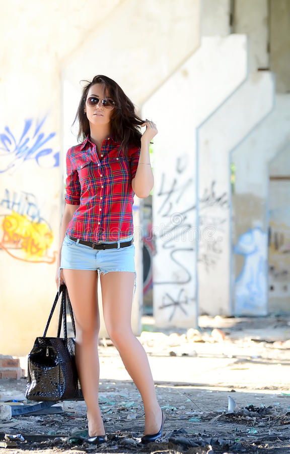 Fashion woman walking on the street royalty free stock images