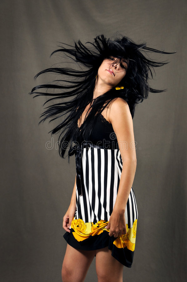 Fashion woman waving hair stock photo