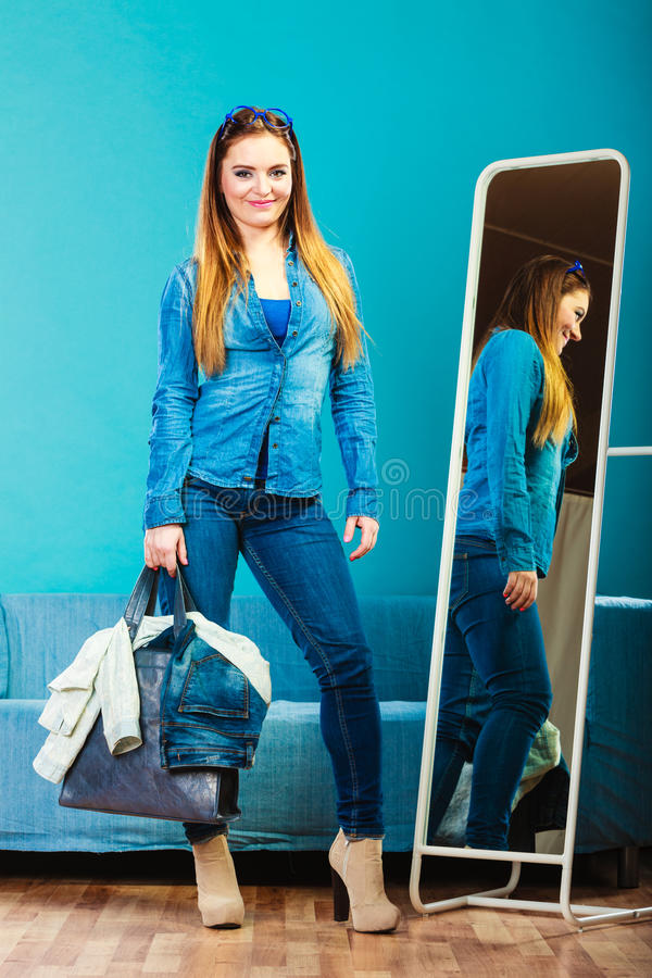 Fashion Woman Wearing Blue Denim In Front Of Mirror Stock