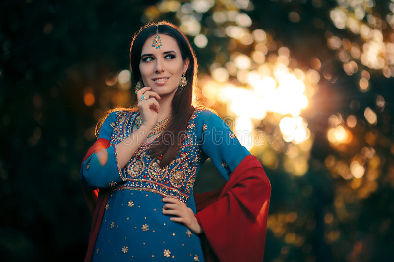 Fashion Woman Wearing Indian Costume and Jewelry Set royalty free stock image