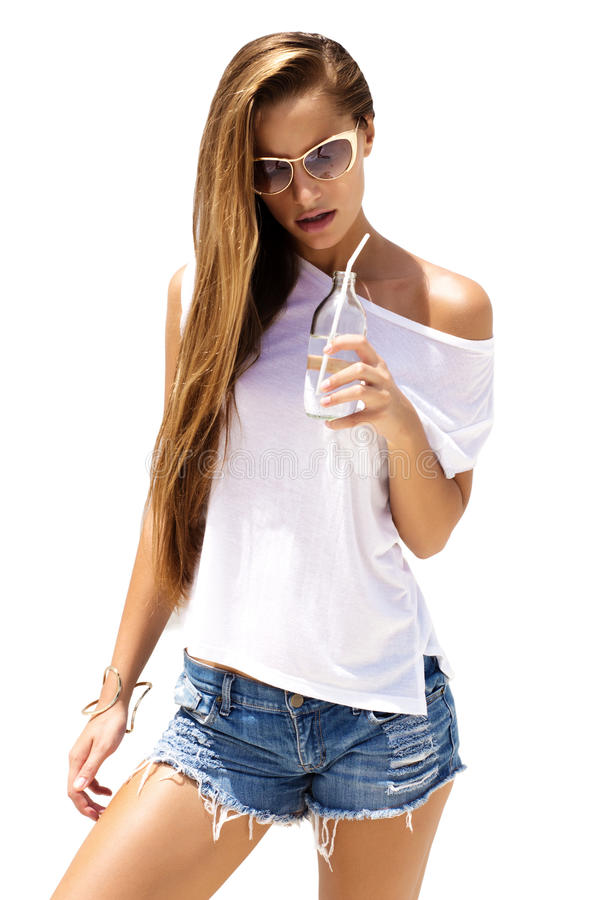Fashion woman wearing stylish look drinks soda and poses on isolated background. stock images