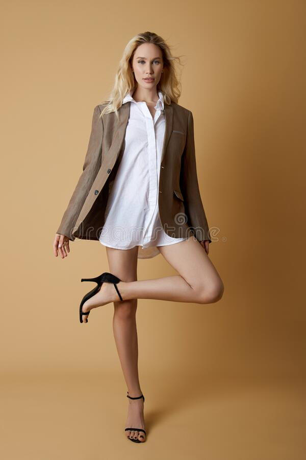 Free Fashion Woman With Long Beautiful Legs, White Shirt And Jacket On The Body Of A Blonde Girl Royalty Free Stock Photos - 186938328
