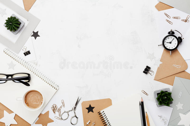 Fashion woman working desk with coffee, office supply, alarm clock and clean notebook top view. Flat lay. Copy space for text. Mockup border for blogging royalty free stock images
