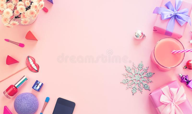 Fashion women accessories cosmetics shoes gift box bow cocktail on pink background Christmas decor decoration cocktail balls gifts. Fashion women accessories royalty free stock photos