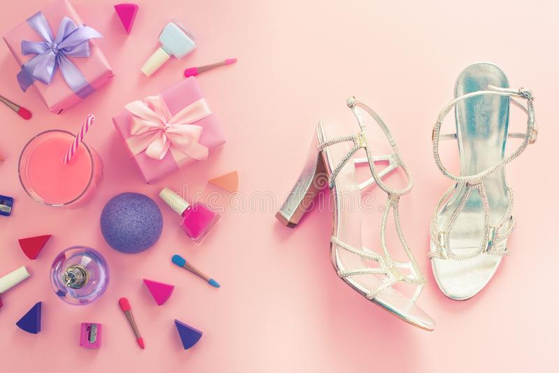 Fashion women accessories cosmetics shoes gift box bow cocktail on pink background Top view flat lay copy space stock photo