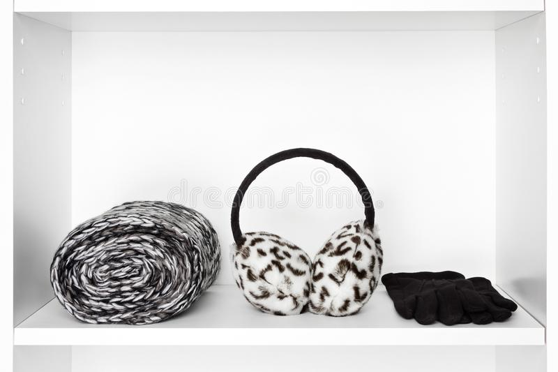 Fashion women accessories on white shelf inside closet royalty free stock photography