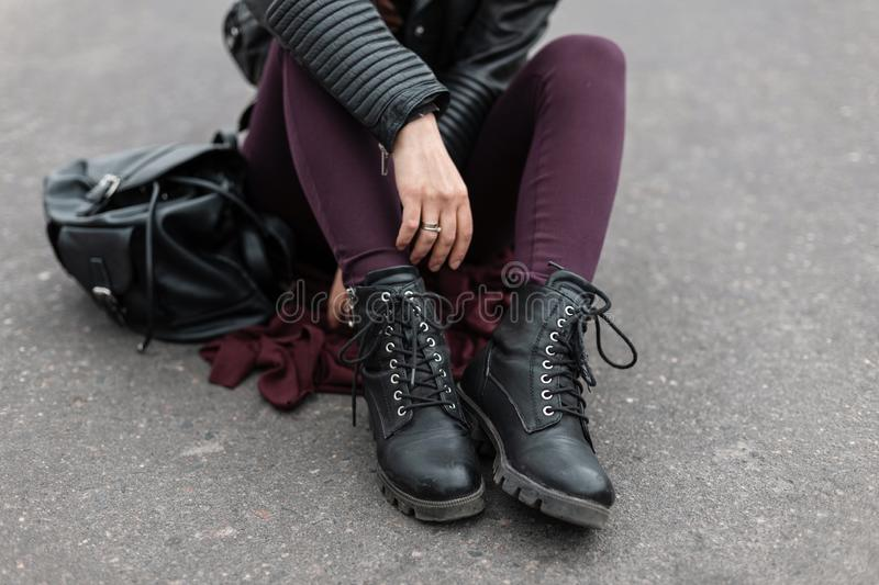 Fashion women clothes. Stylish women`s shoes. Casual design. Street style. Close-up of female legs. royalty free stock image