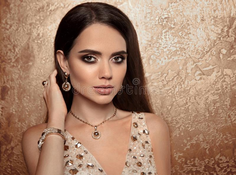 Fashion women golden set of jewelry. Necklace, earrings and bracelet. Beauty and accessories. Elegant lady in gold with royalty free stock image