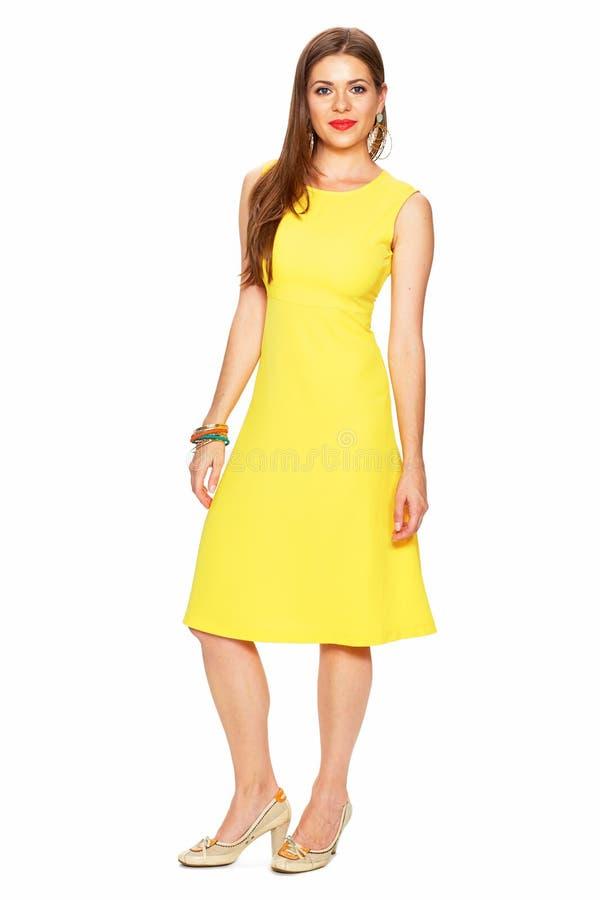 Fashion yellow dress. Smiling woman full body portrait white ba. Ckground isolated stock photos