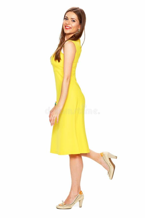 Fashion yellow dress. Smiling woman full body portrait white ba royalty free stock photo