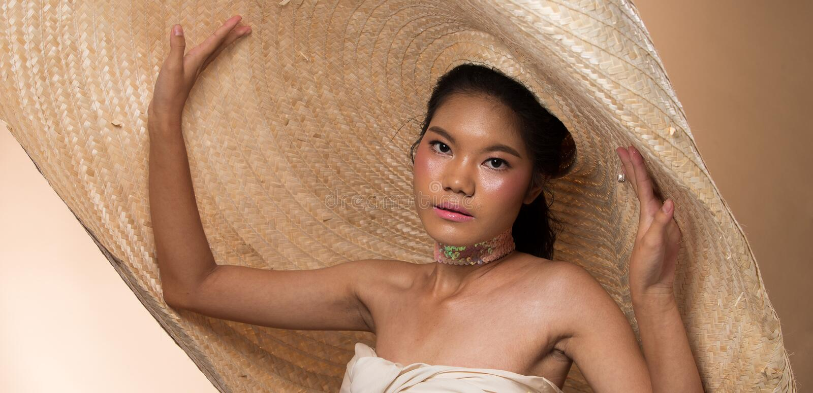 Fashion Young Asian Woman black hair big hat stock images