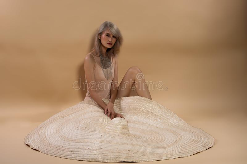 Fashion Young Asian Woman Silver Gray hair big hat stock photography