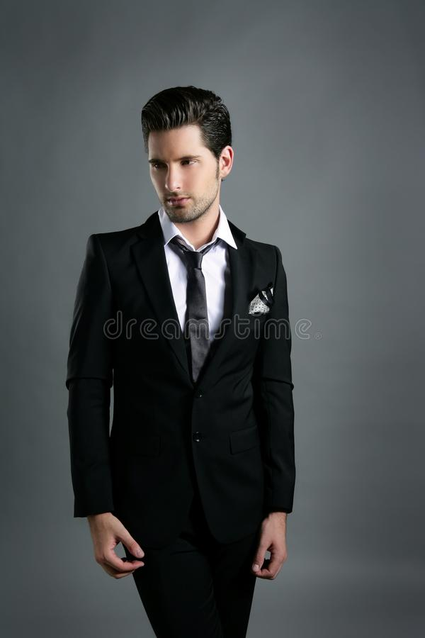 Fashion young businessman black suit casual tie stock photo