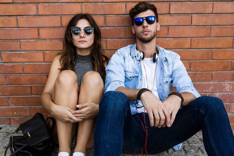 Fashion young couple posing in the street. stock photography
