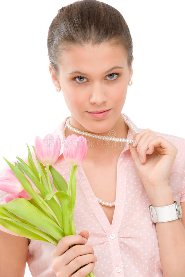 Fashion - young romantic woman with spring tulips royalty free stock photography