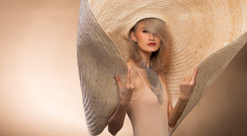 Fashion Young Asian Woman Silver Gray hair big hat royalty free stock photo